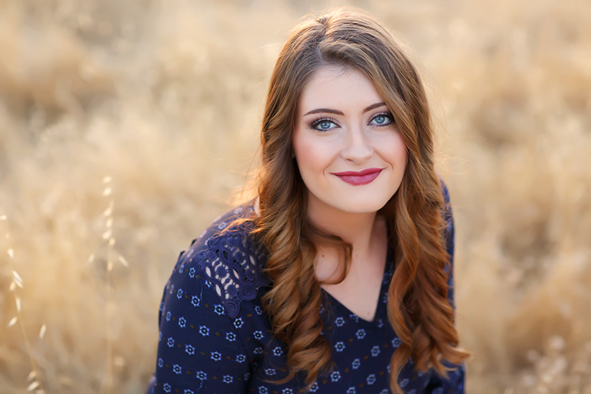 Senior from El Dorado High School in a filed at sunset, blue eyes, blue dress by El Dorado Hills Photographer Colleen Sanders.