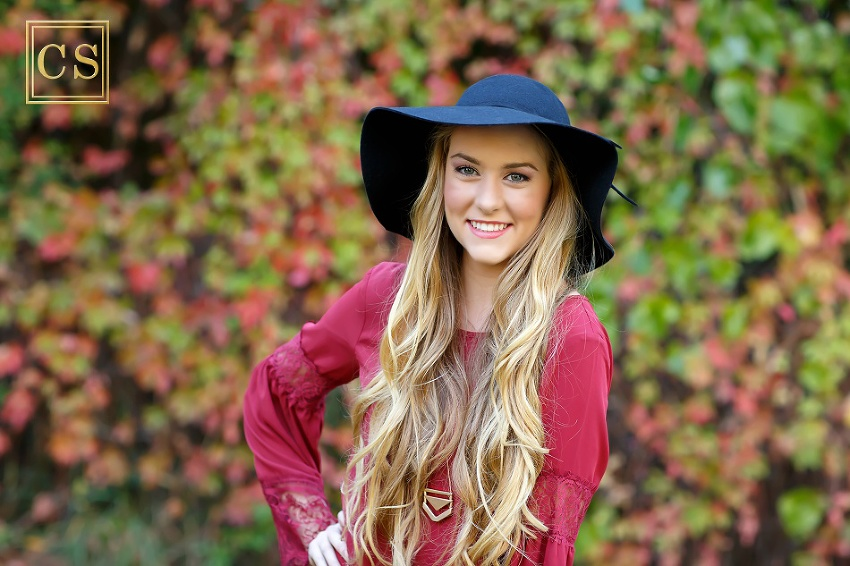 Colleen Sanders Photography senior pictures girl red dress, gold jewelry, hat, fall portraits.