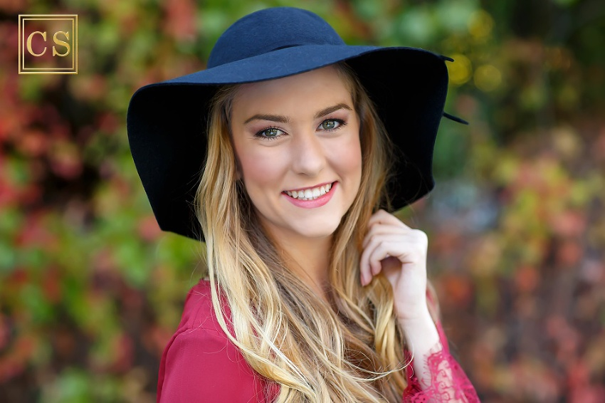 Colleen Sanders Photography senior pictures girl red dress, gold jewelry, hat, fall portraits close up, Oak Ridge High School.