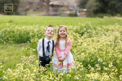 Family pictures in Folsom with yellow flowers, twins boy and girl in suspenders and tie, easter dress by family photographer Colleen Sanders based in El Dorado Hills.